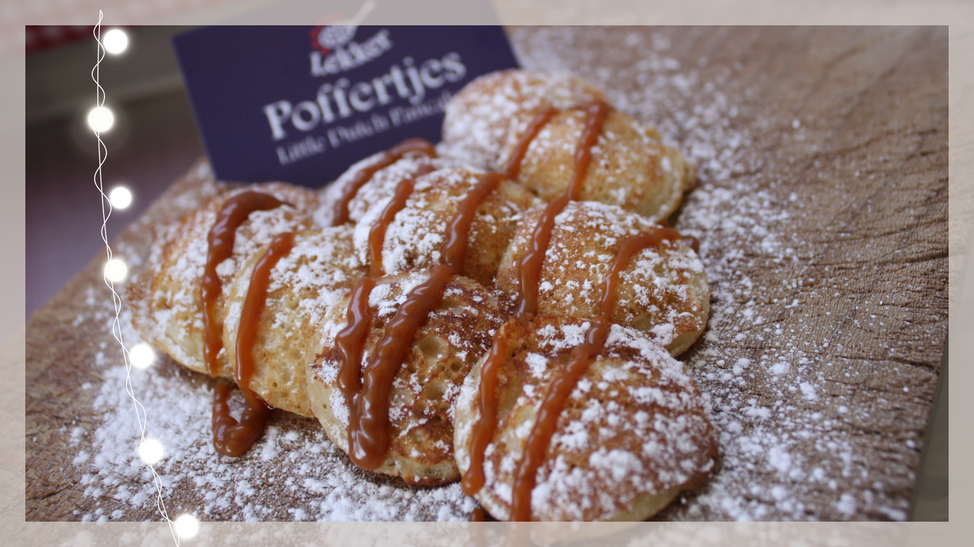 Poffertjes with icing sugar and caramel sauce